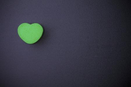 blankness: Heart-shaped cube on blackboard