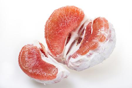 fruitage: Peeled pomelo pieces isolated on white background Stock Photo