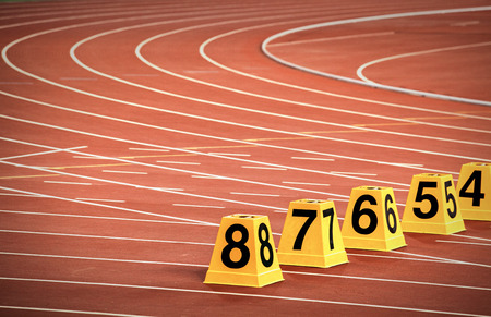athletics track: starting block in track and field, Athletics Track Lane Numbers. Stock Photo