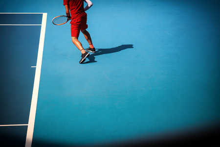 Man plays  at the tennis court