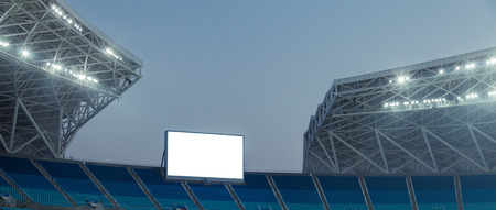 advertising signs: Blue seats and electronic billboard display at stadium
