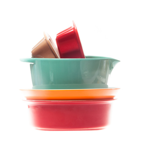 Ceramic colorful  bowls in a stack isolated on white background