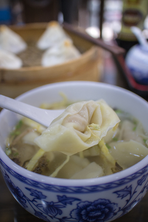 Boiled small dumplings with pork in the Chinese restaurant.