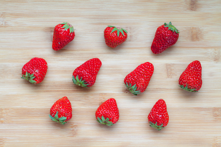 berry: Red fresh strawberries on bamboo board.