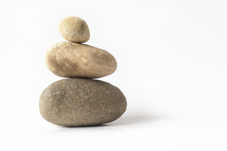 solid: Balanced zen stones pyramid over white Stock Photo