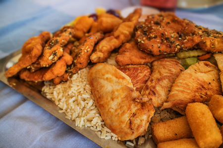 Chicken, pork and rice on a baking tray
