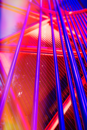 Abstract steel red and blue pipe Background with colorful light, Murinsel, Graz, Austria.