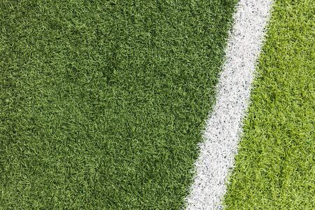 White stripe on the green soccer field from top view Stock fotó