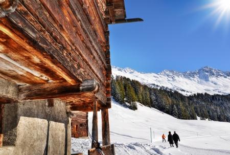 Idyllic winter hiking past woodshed Stock Photo