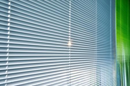 Sunbeam falls through aluminum blinds