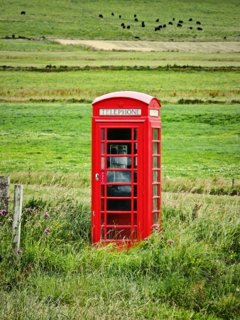 cell phone booth: Lone British Telephone Box Stock Photo