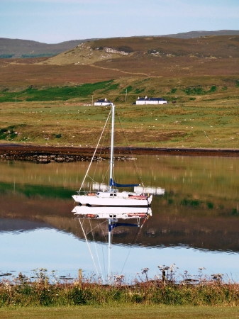 Sailboat anchored in the estuary