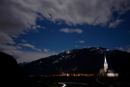 Church and mountains in the moonlight Stock Photo