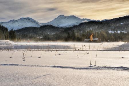 Sunset on the frozen lake Stock Photo