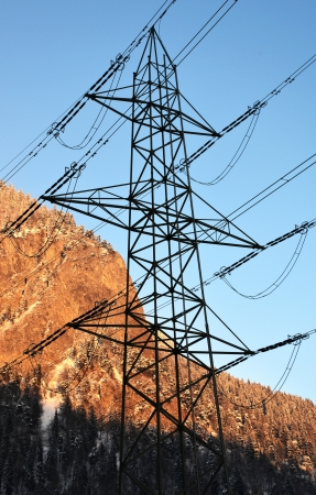 Electrical cable through the mountains Stock Photo