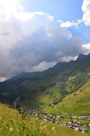 Dark clouds and sunshine over the mountain village