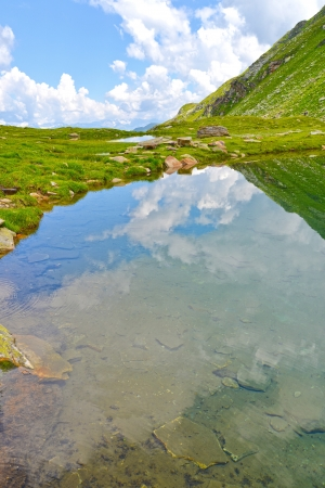 Crystal clear mountain lake in the Swiss Alps Stock Photo