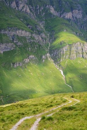 Hiking in an impressive mountain backdrop Stock Photo