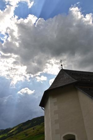 Sun rays over church Stock Photo