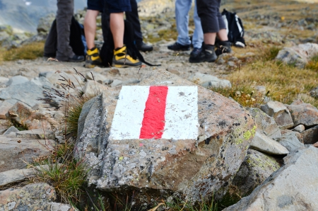 Trail marker in the Swiss alps Stock Photo