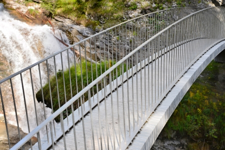 beautiful bridge over mountain stream