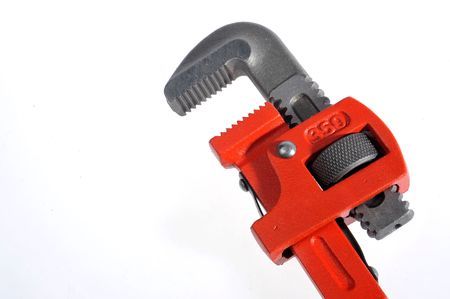 A red tube clamp on a white background photo