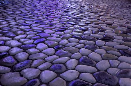 irradiation: Pebbles on the ground under the neon light irradiation Stock Photo