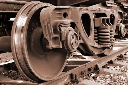 Rusty and polished freight train wheel on railroad track Stock Photo