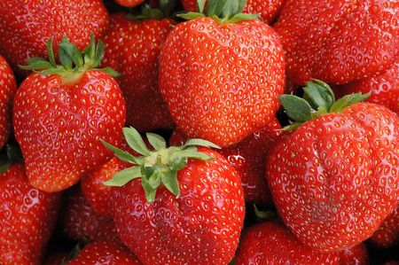 reg:  Together many of the mature strawberry                                Stock Photo