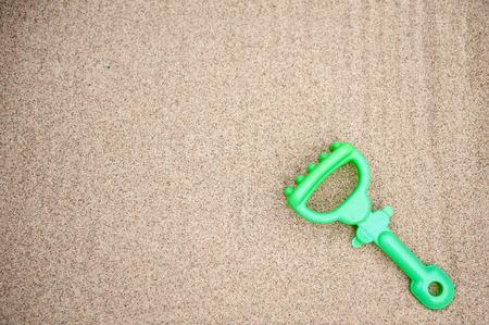 Plastic rake toy on beach sand