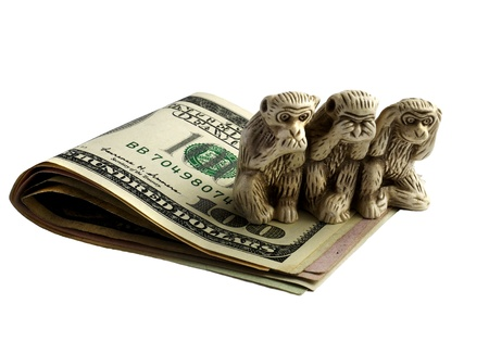 deafness: statuette of three monkeys on the dollar collapsed, symbolizes