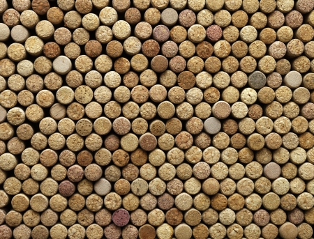 many different wine corks in the background, texture