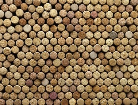 cork: muchos corchos de vino distintos en el fondo, la textura Foto de archivo