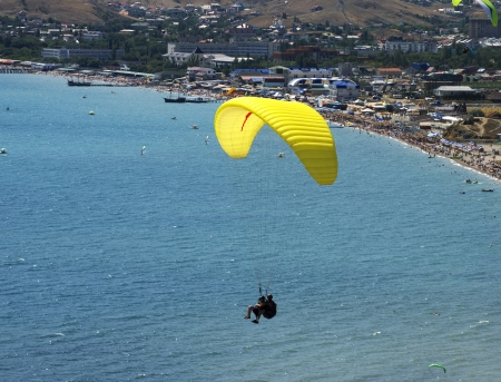 paraglide: over the coast flight on a paraglide with instructor