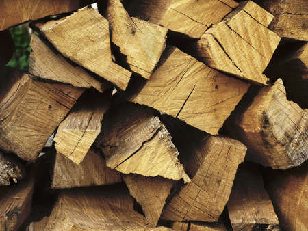 barbecues: end faces firewood that are stacked  for barbecues Stock Photo