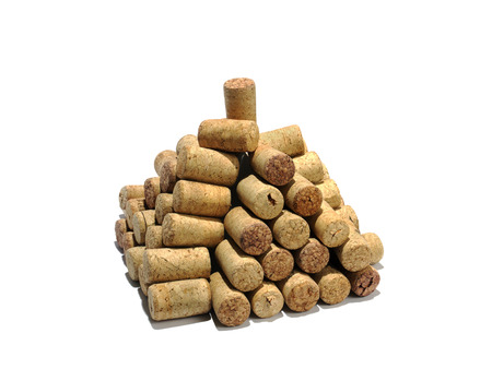 tartaric: Pyramid from wine corks on a white , isolated