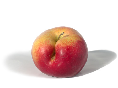 flaw: yellow-red apple with a flaw on a white background Stock Photo