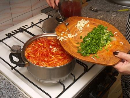 сooking: сooking Ukrainian borscht, the addition of garlic and onions Stock Photo
