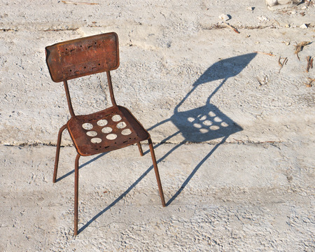 metal base: rusty metal frame of chair with shadow