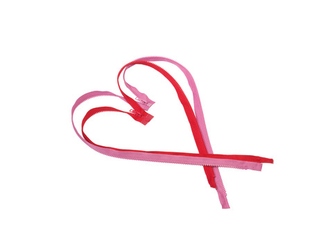 fastener: Red and pink zip zipper fastener in the form of heart