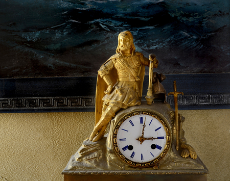 18th century: antique French mantel clock and gilded statuette of King, 18th century
