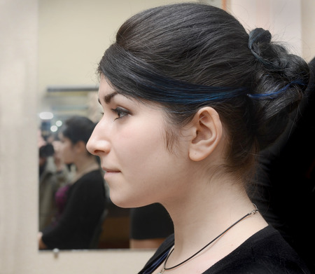 profile of young girl with black hair, aquiline nose