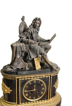 18th century: antique French mantel clock and statuette of King, 18th century Stock Photo