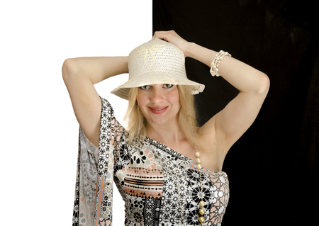 woman in straw hat smiling, black and white background