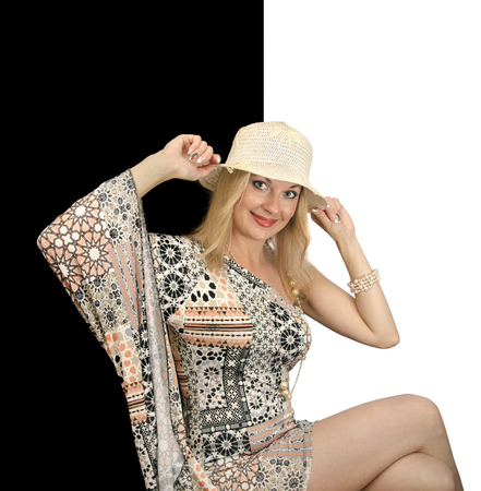 chaff: woman in straw hat smiling, black and white background