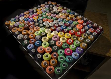 lot of colorful reels of threads for embroidery in box