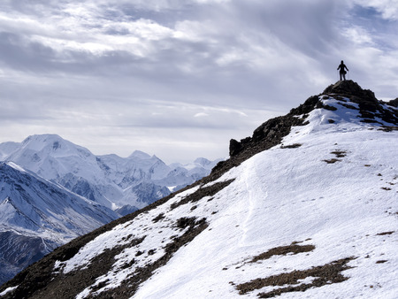 highest: Mt. Mckinley in View - Lone Climber Stock Photo
