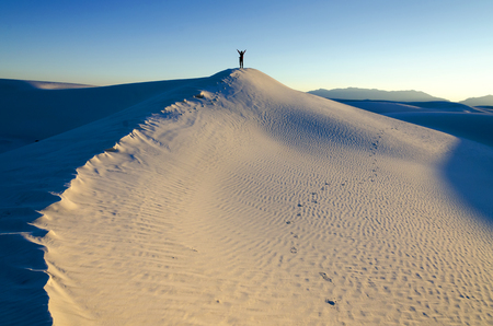 chihuahua desert: Hiker On Top of a Sand Dune Stock Photo