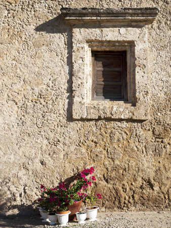 adobe wall: Rustic Adobe Wall with Decorative Window Frame
