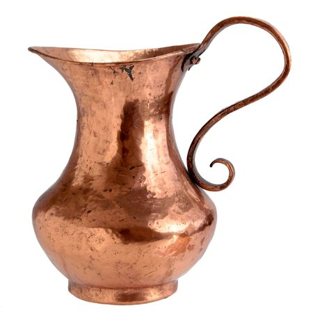 Copper pitcher Stock Photo